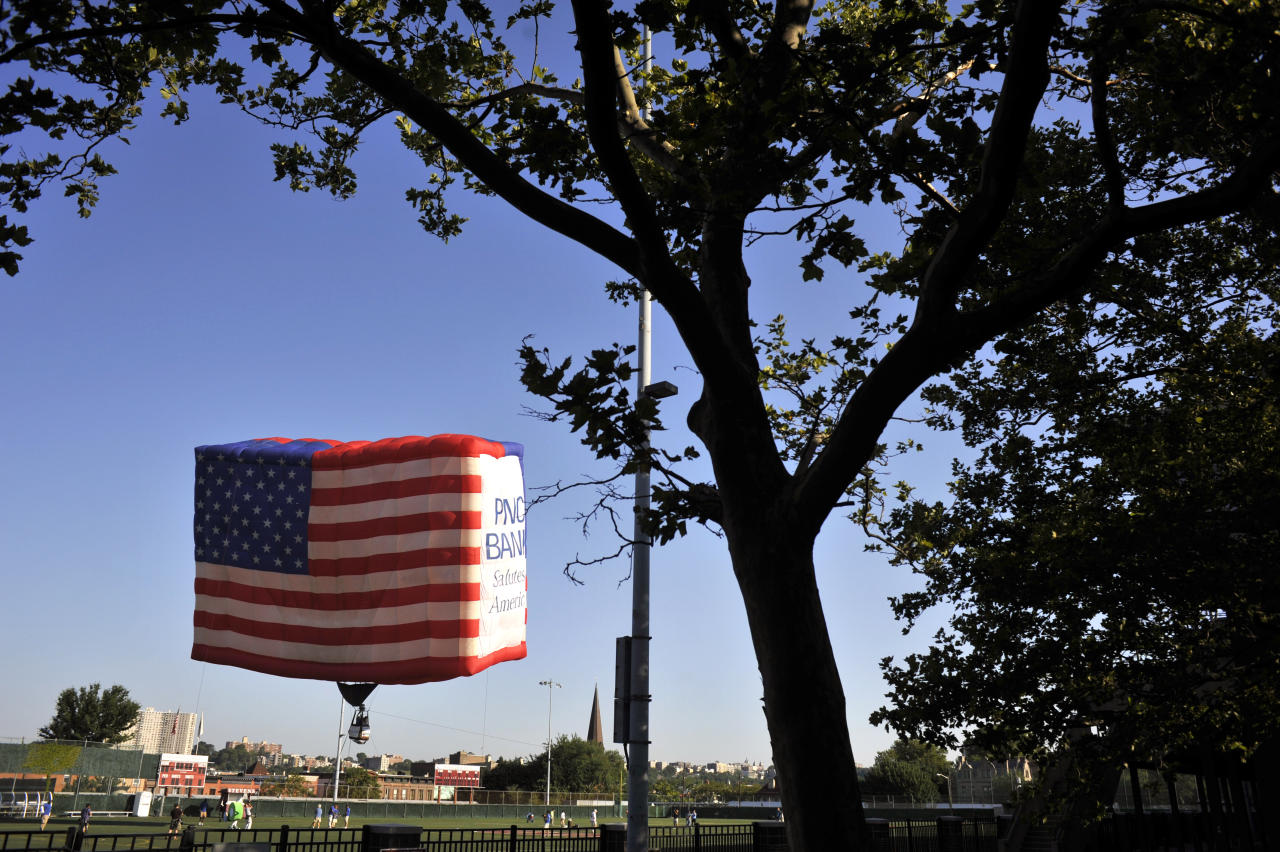 The PNC American Flag balloon is raised in honor of America for Independence Day on the De Baun Athletic Complex at Stevens Institute of Technology on July 3, 2012 in Hoboken, New Jersey. The 53 by 78 foot balloon is the world's largest free-flying American flag, weighs 530 pounds and is being flown in the upcoming 30th annual NJ Festival of Ballooning. (Photo by Michael Bocchieri/Getty Images)