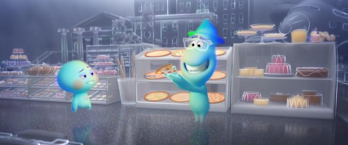 "Joe (voiced by Jamie Foxx, left) tries to educate 22 (Tina Fey) on the joys of pizza in ""Soul."""