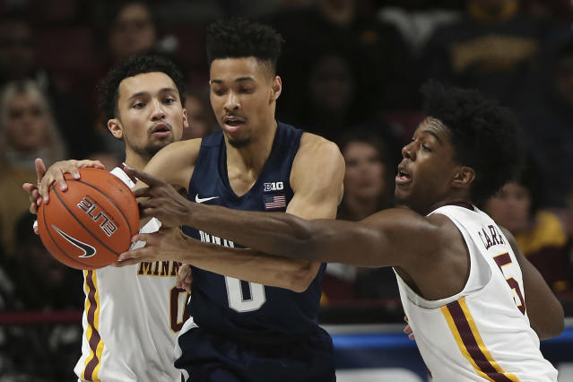 Penn State's Myreon Jones protects the ball against Minnesota's Payton Willis, left, and Marcus Carr, right, during an NCAA basketball game Wednesday, Jan. 15, 2020, in Minneapolis. (AP Photo/Stacy Bengs)