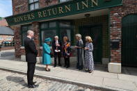 Britain's Queen Elizabeth II meets actors William Roache, fourth right, Barbara Knox, third right, Sue Nicholls and Helen Worth, right, during a visit to the set of the long running television series Coronation Street, in Manchester, England, Thursday July 8, 2021. (AP Photo/Scott Heppell)