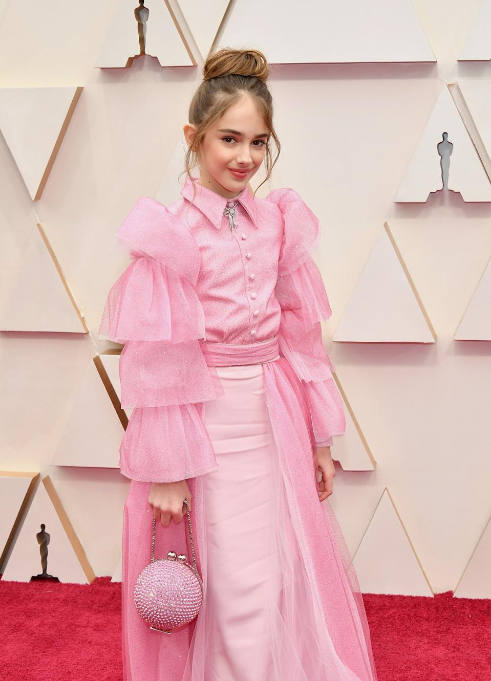 Julia Butters, 10, used the space in her six-inch crystal purse wisely at the Oscars: She packed a sandwich in it. (Photo: Amy Sussman/Getty Images)
