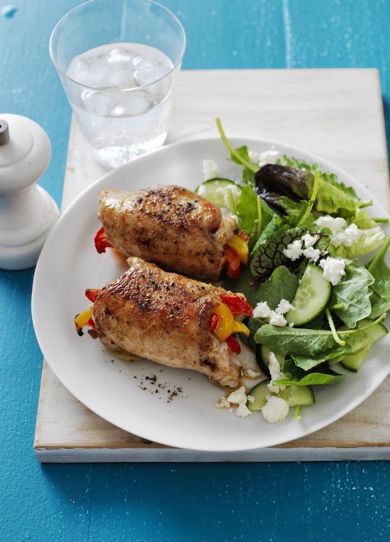 """<p>This 30-minute meal has all the flavor you love, without the dangerously hot fajita pan.</p><p><em><a href=""""https://www.womansday.com/food-recipes/food-drinks/recipes/a57701/fajita-chicken-roll-ups-recipe/"""" rel=""""nofollow noopener"""" target=""""_blank"""" data-ylk=""""slk:Get the Fajita Chicken Roll-Ups recipe."""" class=""""link rapid-noclick-resp"""">Get the Fajita Chicken Roll-Ups recipe.</a></em></p>"""