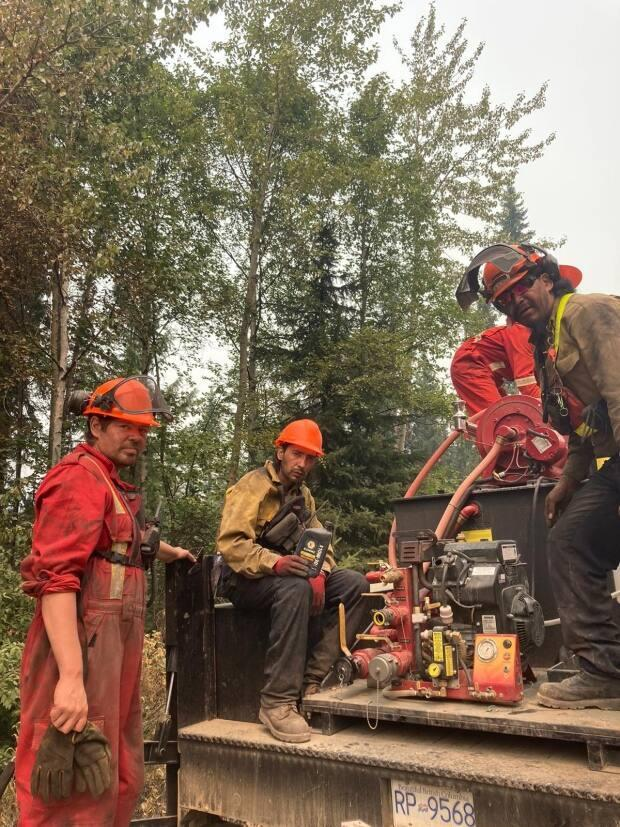 An all-Indigenous Simpcw First Nation wildfire attack crew at work in the North Thompson region near Kamloops, B.C., in August.  (Melanie Stutt  - image credit)