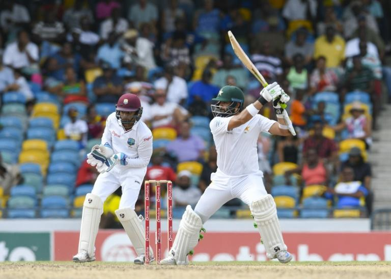 Azhar Ali (R) of Pakistan hits 4 during the 2nd day of the 2nd Test match between West Indies and Pakistan at Kensington Oval, Bridgetown, Barbados on May 1, 2017