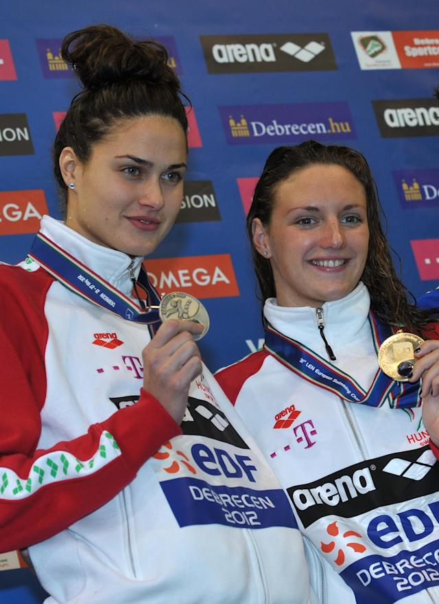 Gold medallist, Hungary's Katinka Hosszu (R) and silver medallist, compatriot Zsuzsanna Jakabos pose on the podium after competing in the final of the women's 200-metre butterfly swimming event in the 31st European Swimming Championships in Debrecen, on May 27, 2012. AFP PHOTO / BEN STANSALLBEN STANSALL/AFP/GettyImages