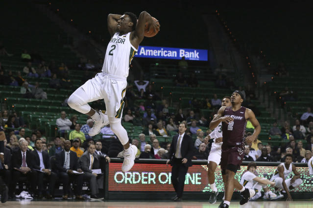 Baylor guard Devonte Bandoo, left, dunks over Maryland-Eastern Shore guard Ty Gibson, right, in the second half of an NCAA college basketball game, Tuesday, Dec. 3, 2019, in Waco, Texas. (AP Photo/Rod Aydelotte)