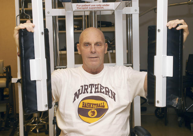 FILE - In this Oct. 16, 2008 file photo, Northern State University men's basketball coach Don Meyer works on his upper body strength as he undergoes rehabilitation following a life threatening car crash at Avera McKennan Hospital in Sioux Falls, S.D. Meyer, one of the winningest coaches in college basketball who came back from a near-fatal car accident and liver cancer before closing out his career, died Sunday, May 18, 2014 in South Dakota. He was 69. (AP Photo/Doug Dreyer, File)