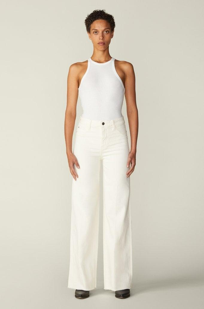 """<p>""""Nothing says 'optimism' like Warp + Weft's white, high-waist <span>NCE wide-leg jeans</span> ($98). Since the days are all blending together anyway, I figure there's no harm in breaking the dated 'not after Labor Day' rule. Plus, Warp + Weft prides itself on sustainability - a regular pair of jeans uses 1,500 gallons of water, whereas their styles require fewer than 10 gallons. The more you know!""""</p>"""