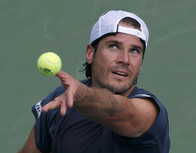 Tommy Haas of Germany serves to Lu Yen-Hsun of Taiwan at the U.S. Open tennis championships in New York August 30, 2013. REUTERS/Mike Segar (UNITED STATES - Tags: SPORT TENNIS)