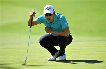 Sang-Moon Bae lines up his putt on the eighteenth hole green during the second round of the Northern Trust Open at Riviera Country Club. Mandatory Credit: Gary A. Vasquez-USA TODAY Sports