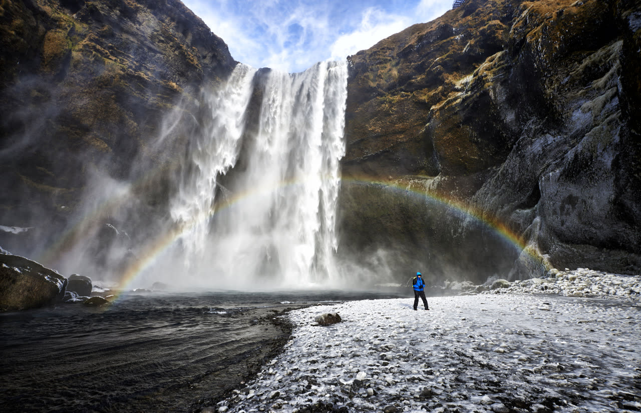 A rainbow appears in front of a waterfall in Iceland. (Michael Fersch/Caters News Agency)