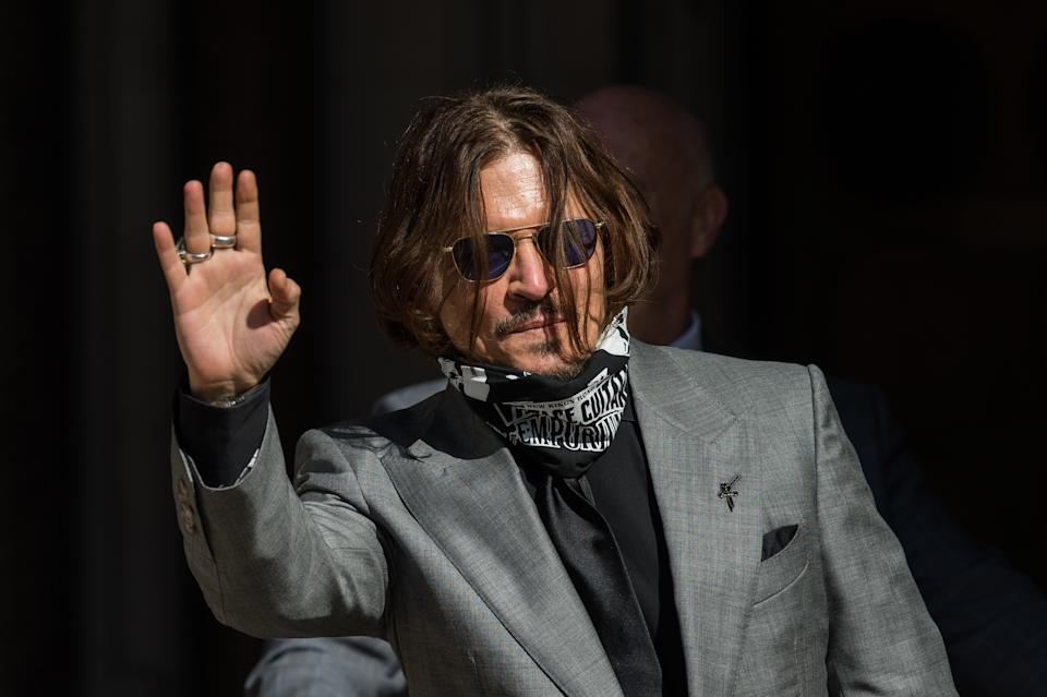 Johnny Depp arrives at the Royal Courts of Justice on the final day of the hearing on the libel case against The Sun newspaper on 28 July, 2020 in London, England. Today the court will hear final submissions from David Sherborne on behalf of Johnny Depp who is suing the The Sun's publisher, News Group Newspapers, over a 2018 article in which he was accused of being violent towards Amber Heard during their marriage. (Photo by WIktor Szymanowicz/NurPhoto via Getty Images)