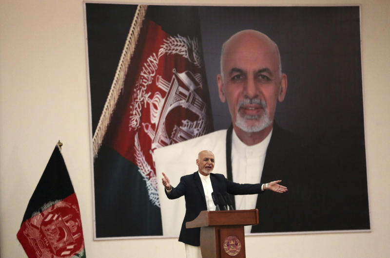 FILE - In this Sept. 9, 2019, file photo, Afghan President Ashraf Ghani speaks during a ceremony to introduce the new chief of the intelligence service, in Kabul, Afghanistan. President Donald Trump's halt to U.S.-Taliban talks looks like a gift to the beleaguered Afghan president, who has insisted on holding a key election in less than three weeks' time despite widespread expectations that a peace deal would push it aside. (AP Photo/Rahmat Gul, File)