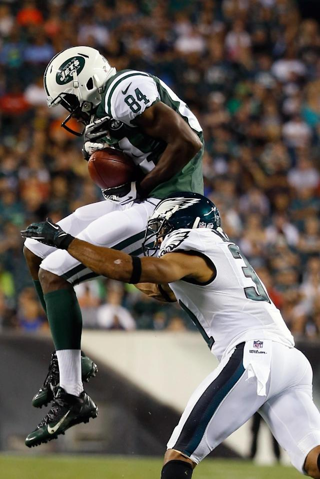 New York Jets' Stephen Hill (84) cannot hang onto a pass as Philadelphia Eagles' Curtis Marsh (31) defends during the first half of an NFL preseason football game, Thursday, Aug. 28, 2014, in Philadelphia. (AP Photo/Chris Szagola)