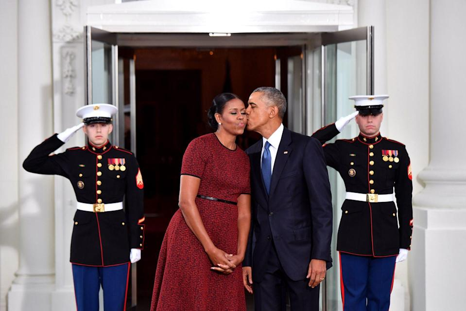 <p>Barack gave his wife a kiss as they left the White House in January 2017. </p>
