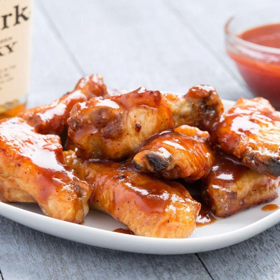 """<p>When you want to take a break from buffalo, reach for <a href=""""https://www.delish.com/uk/cooking/recipes/a28826259/easy-homemade-bbq-sauce-recipe/"""" rel=""""nofollow noopener"""" target=""""_blank"""" data-ylk=""""slk:barbecue sauce"""" class=""""link rapid-noclick-resp"""">barbecue sauce</a>—and bourbon for good measure.</p><p>Get the <a href=""""https://www.delish.com/uk/cooking/recipes/a32846813/slow-cooker-barbecue-bourbon-chicken-wings-recipe/"""" rel=""""nofollow noopener"""" target=""""_blank"""" data-ylk=""""slk:Slow Cooker Barbecue-Bourbon Chicken Wings"""" class=""""link rapid-noclick-resp"""">Slow Cooker Barbecue-Bourbon Chicken Wings</a> recipe.</p>"""