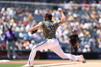 San Diego Padres starting pitcher Reiss Knehr winds up against the Colorado Rockies in the first inning of a baseball game Sunday, Aug. 1, 2021, in San Diego. (AP Photo/Derrick Tuskan)