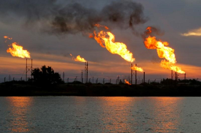 Flames emerge from flare stacks at the oil fields in Basra
