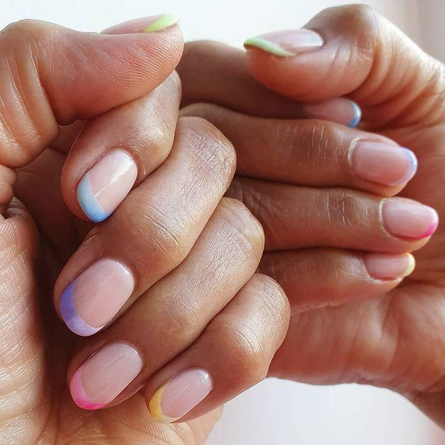 """<p>Bring together two of the biggest nail trends this season with these delicate ombre french tips.</p><p><a href=""""https://www.instagram.com/p/CDbG1DlDKYz/"""" rel=""""nofollow noopener"""" target=""""_blank"""" data-ylk=""""slk:See the original post on Instagram"""" class=""""link rapid-noclick-resp"""">See the original post on Instagram</a></p>"""