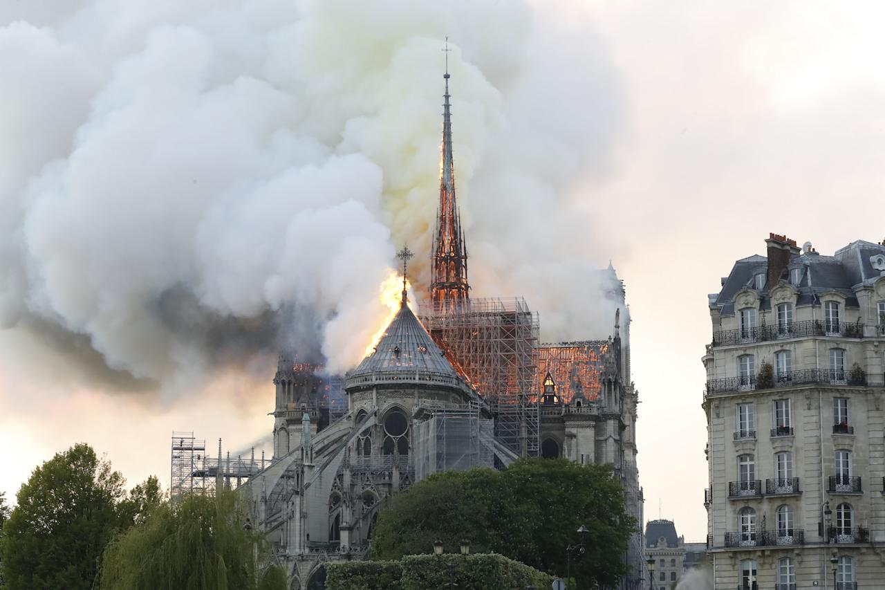 <p>Plumes of smoke and flames rise during a fire at the landmark Notre Dame Cathedral in central Paris on April 15, 2019, potentially involving renovation works being carried out at the site, the fire service said. (Photo credit by FRANCOIS GUILLOT/AFP/Getty Images) </p>
