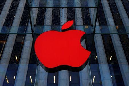 An Apple logo hangs above the entrance to the Apple store on 5th Avenue in the Manhattan borough of New York