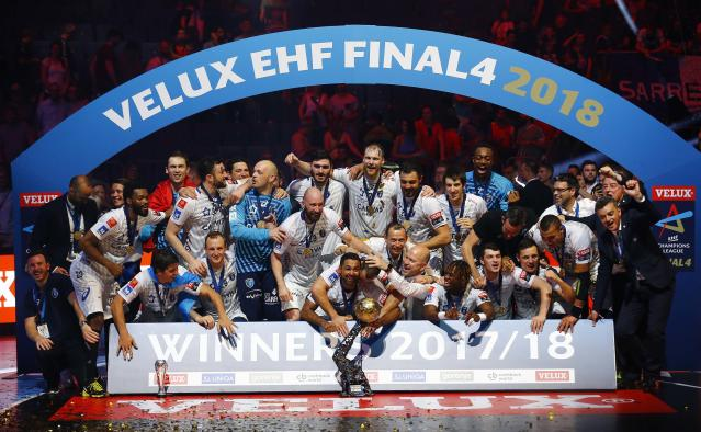 Handball - Men's EHF Champions League Final - HBC Nantes vs Montpellier HB - Lanxess Arena, Cologne, Germany - May 27, 2018. Montpellier HB players celebrate with the trophy. REUTERS/Thilo Schmuelgen