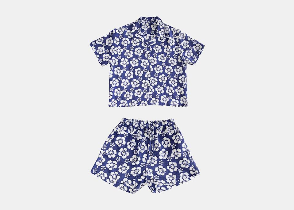 """For an actually cool dad-on-vacation look, this floral Holiday the Label set will do the trick. Made from linen with a drawstring short and button-up top, it's just what you want to wear over a bathing suit this summer. It's also available in gingham and checked prints; senior editorial operations manager Lale Arikoglu has the set in <a href=""""https://cna.st/affiliate-link/3vX4W1jLT426eg7kDW55S6SARNBEWMtEh7nk2XzWFqY5LepDEVcxq8B8jJxqe7w6kJFzEEsJSqYzfYvugupKr9dZfLjLRH3gQftiTP9zgS8Q1VXeDLUVzMp9ws6ArMbC1zByVF4GETjmnmoFxFuPMLTD52cFy612TrgtoSp3y1EZKL2tDSG2bhmTZH8T14F9Shcx8?cid=60db4737fa2963639daee574"""" rel=""""nofollow noopener"""" target=""""_blank"""" data-ylk=""""slk:tie-dye"""" class=""""link rapid-noclick-resp"""">tie-dye</a>. $169, Holiday the Label. <a href=""""https://holidaythelabel.com/collections/pyjamas/products/pyjama-short-set-happy-hawaii-navy"""" rel=""""nofollow noopener"""" target=""""_blank"""" data-ylk=""""slk:Get it now!"""" class=""""link rapid-noclick-resp"""">Get it now!</a>"""