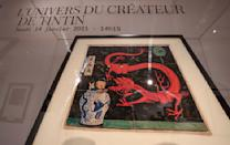 """The inked and water-painted original panel of the comic character Tintin from the 1936 """"The Blue Lotus"""" album drawn by Belgian creator Herge, is displayed at the Artcurial auction house in Paris, Wednesday, Jan. 13, 2021. The art work with an estimates value of 2.2 to 2.8 million euros (US $ 2.6 to 3.4 million), is going on sale Thursday. (AP Photo/Michel Euler)"""