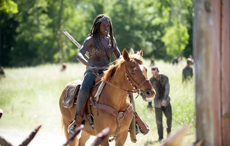 "This image released by AMC shows Danai Gurira as Michonne in a scene from ""The Walking Dead,"" premiering Oct. 13 at 9 p.m. EST. (AP Photo/AMC, Gene Page)"