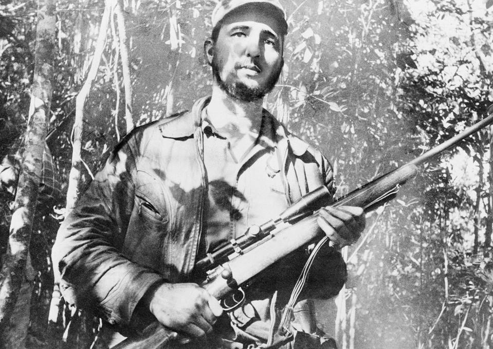 <p>Fidel Castro, leader of a continuing revolt against President Fulgencio Batista and his regime on Sept. 10, 1957, takes time to do some evading at his mountain hideout in eastern Cuba. (AP Photo/Andrew St. George) </p>