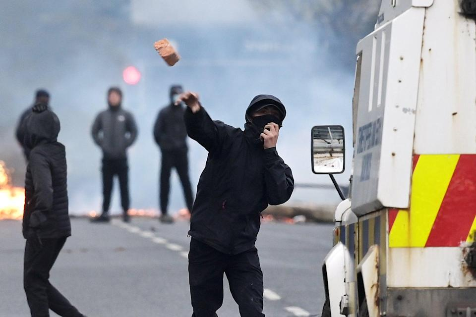 <p>Furniture was set on fire in the road in Belfast this evening</p> (PA)