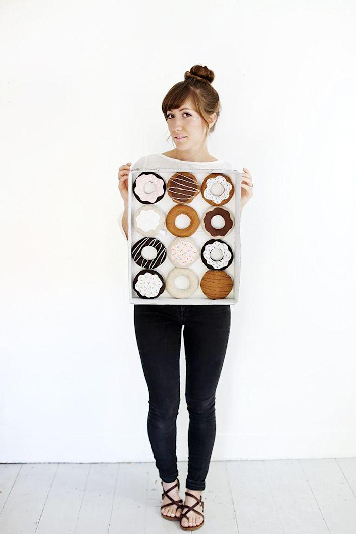 """<p>This sweet costume looks almost good enough to eat! The treats are made from felt, but they'll probably give you donut cravings anyway!</p><p><strong>See more at <a href=""""https://themerrythought.com/diy/diy-dozen-donuts-costume/"""" rel=""""nofollow noopener"""" target=""""_blank"""" data-ylk=""""slk:The Merrythought"""" class=""""link rapid-noclick-resp"""">The Merrythought</a>. </strong></p><p><a class=""""link rapid-noclick-resp"""" href=""""https://www.amazon.com/42pcs-Fabric-Assorted-Squares-Nonwoven/dp/B01GCLS32M/ref=sr_1_1_sspa?tag=syn-yahoo-20&ascsubtag=%5Bartid%7C2164.g.37115224%5Bsrc%7Cyahoo-us"""" rel=""""nofollow noopener"""" target=""""_blank"""" data-ylk=""""slk:SHOP FELT SQUARES"""">SHOP FELT SQUARES</a></p>"""