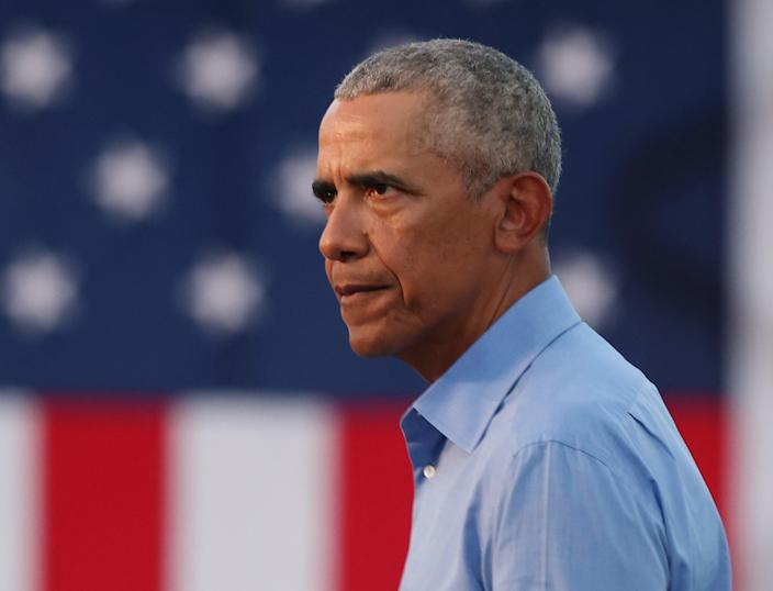<p>Former President Barack Obama speaks during a drive-in rally while campaigning for Democratic nominee Joseph Biden, on October 21, 2020 in Philadelphia, Pennsylvania. </p> (Photo by Michael M. Santiago/Getty Images))