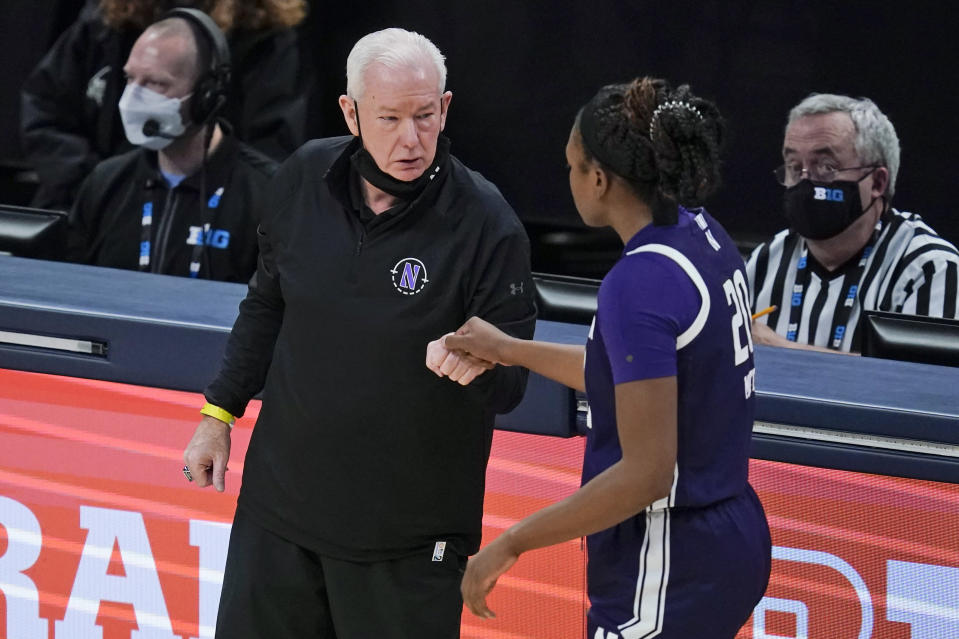 Northwestern head coach Joe McKeown talks with Paige Mott during the second half of an NCAA college basketball semifinal game against Maryland at the Big Ten Conference tournament, Friday, March 12, 2021, in Indianapolis. (AP Photo/Darron Cummings)
