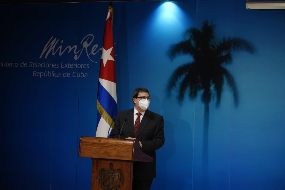 Cuban Foreign Minister Bruno Rodríguez Parrilla, wearing a mask amid the COVID-19 pandemic, presents Cuba's report on the impact of the US embargo policy on the island over the past year, at the Foreign Affairs Ministry in Havana, Cuba, Thursday, Oct. 22, 2020. (AP Photo/Ramon Espinosa)