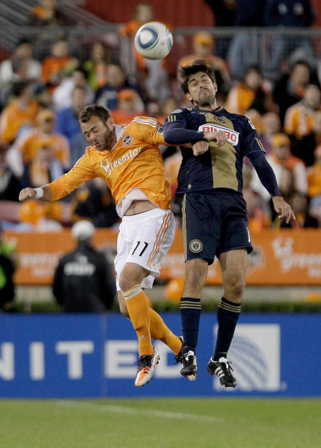 HOUSTON, TX - NOVEMBER 03: Brad Davis #11 of the Houston Dynamo heads the ball against Velijko Paunovic #16 of the Philadelphia Union in the second leg of the playoffs on November 3, 2011 at Robertson Stadium in Houston, Texas. The Dynamo won 1 to 0 and will play the Sporting K.C. Sunday, November 6, 2011. (Photo by Thomas B. Shea/Getty Images)