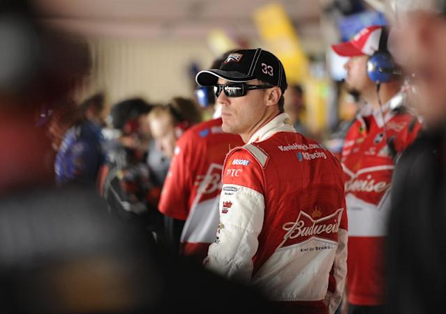 Kevin Harvick looks on in the garage during practice for Sunday's NASCAR Sprint Cup series auto race, Friday, Sept. 27, 2013, at Dover International Speedway in Dover, Del. (AP Photo/Nick Wass)