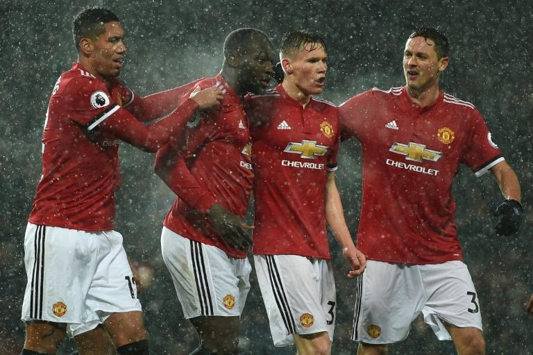Manchester United's Romelu Lukaku (2nd L) celebrates with teammates after scoring during their English Premier League match against Bournemouth, at Old Trafford in Manchester, on December 13, 2017