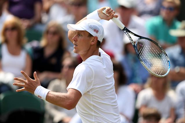 LONDON, ENGLAND - JUNE 27: Tomas Berdych of Czech Republic plays a forehand during his Gentlemen's Singles second round match against Daniel Brands of Germany on day four of the Wimbledon Lawn Tennis Championships at the All England Lawn Tennis and Croquet Club on June 27, 2013 in London, England. (Photo by Clive Brunskill/Getty Images)