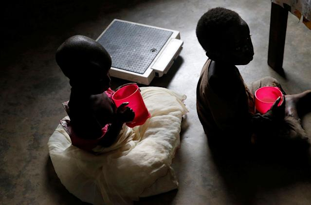 <p>Severely acute malnourished and internally displaced Congolese children drink porridge as they wait to receive medical attention at the Tshiamala general referral hospital of Mwene Ditu in Kasai Oriental Province in the Democratic Republic of Congo, March 15, 2018. (Photo: Thomas Mukoya/Reuters) </p>
