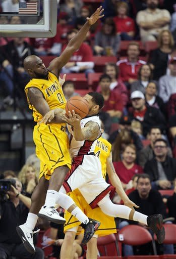 Wyoming's Leonard Washington (0) pressures UNLV's Anthony Marshall (3) into a pass in the first half of an NCAA college basketball game, Thursday, Jan. 24, 2013, in Las Vegas. (AP Photo/Julie Jacobson)