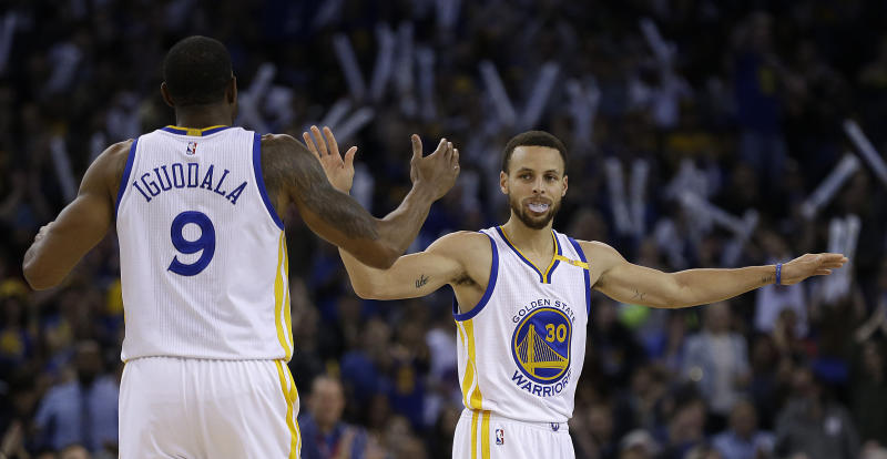 Warriors use big fourth quarter to hold off Rockets 107-98