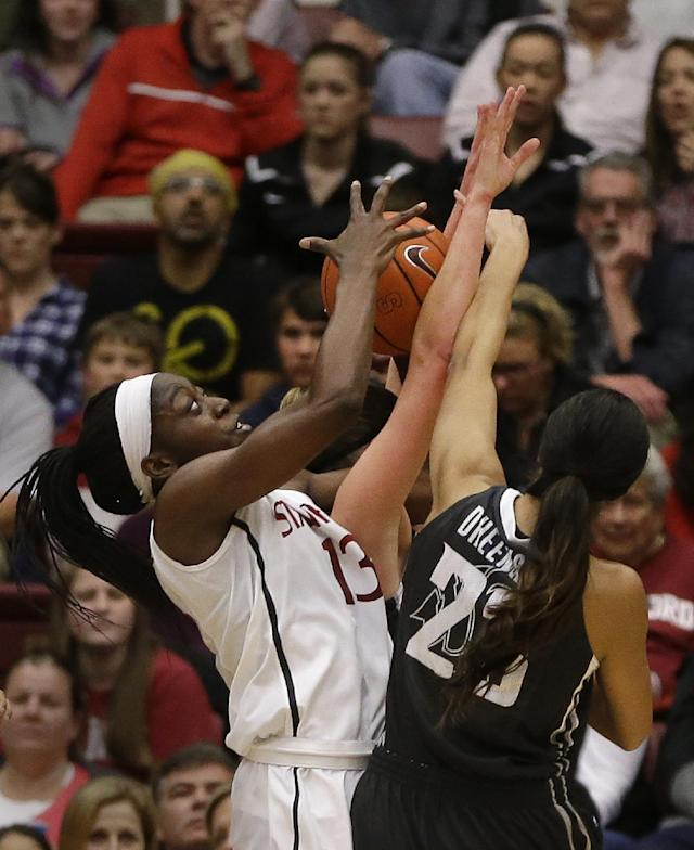 Stanford's Chiney Ogwumike (13) rebounds against Washington State's Shalie Dheensaw during the first half of an NCAA college basketball game Saturday, March 1, 2014, in Stanford, Calif. (AP Photo/Ben Margot)