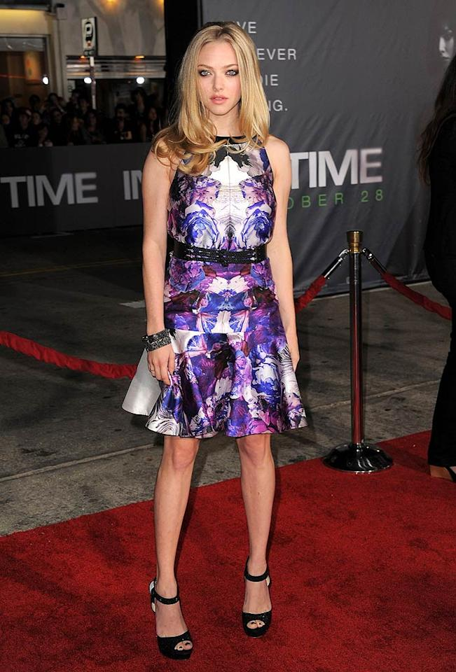 "Amanda Seyfried -- who co-stars alongside Justin Timberlake in ""In Time"" -- rocked the red carpet at the Los Angeles premiere of the thriller in a psychedelic dress courtesy of Prabal Gurung. The blond bombshell perfectly paired the frock with smoky eyeshadow, a metallic bracelet, a trendy harness belt, and basic black peep-toes. (10/20/11)"