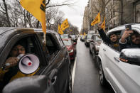 A convoy of protesters drive down Fifth Avenue past the Consulate General of India, Tuesday, Jan. 26, 2021, in the Manhattan borough of New York. Tens of thousands of protesting farmers have marched, rode horses and drove long lines of tractors into India's capital, breaking through police barricades to storm the historic Red Fort. The farmers have been demanding the withdrawal of new laws that they say will favor large corporate farms and devastate the earnings of smaller scale farmers. Republic Day marks the anniversary of the adoption of India's constitution on Jan. 26, 1950. (AP Photo/John Minchillo)