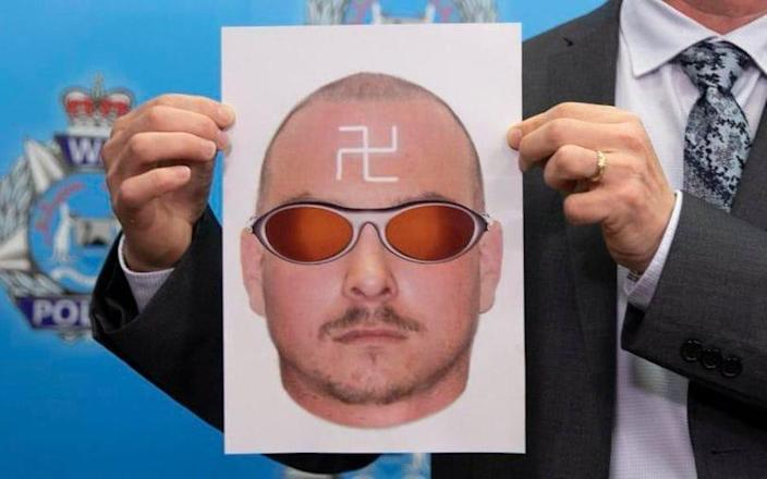 A composite image of the attacker, who had a white Swastika painted backwards on his forehead, has been released