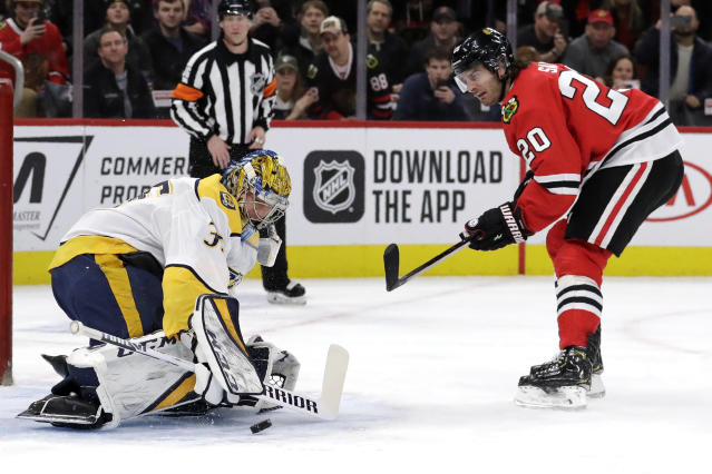 Nashville Predators goalie Pekka Rinne, left, blocks a penalty shot by Chicago Blackhawks left wing Brandon Saad during the first period of an NHL hockey game in Chicago, Friday, Feb. 21, 2020. (AP Photo/Nam Y. Huh)