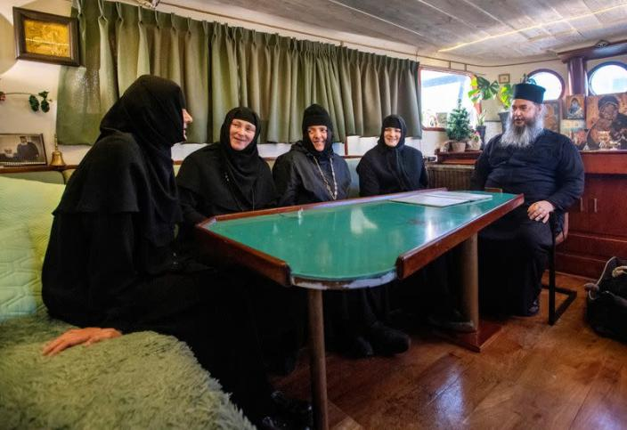 Nuns and father Abbot Abibos sit in the livingroom of a mobile Georgian Orthodox monastery in Vlissingen