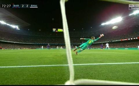Lionel Messi helped 10-man Barcelona remain undefeated in the Spanish league after drawing 2-2 with Real Madrid on Sunday in a testy El Clasico that saw Cristiano Ronaldo substituted at half-time with a leg injury. Ronaldo hurt his lower right leg while canceling out Luis Suarez's opener in the 10th minute. Gerard Pique stepped on his ankle as he unsuccessfully tried to stop the Madrid forward from scoring from close range. Ronaldo played on until halftime, when he was replaced by Marco Asensio. Madrid was dominating the match at Camp Nou and Barcelona right back Sergi Roberto was shown a direct red card in first-half injury time for swiping his hand at Marcelo's face as tempers flared between the rivals. But that was when Messi came to the hosts' rescue, sending the ball past Keylor Navas in the 52nd to swing the match back in Barcelona's favor despite playing a man down. Luis Suarez opens the scoring for Barcelona Credit: AP Gareth Bale pulled Madrid level again in the 72nd after curling in a pass by Asensio. Messi had more chances to grab the late winner but was denied by Navas. Champion Barcelona stayed unbeaten through 35 league matches this season and extended its record run to 42 consecutive games without a loss. Its last defeat in La Liga was at Malaga in April 2017. Barcelona has matches left against Villarreal, Levante and Real Sociedad to try and become the first team to go unbeaten in the competition since the 1930s, when it consisted of 10 teams compared to 20 now. 9:42PM FULL-TIME: BARCELONA 2-2 REAL MADRID Another corner! Ramos however commits a foul, and Barcelona's unbeaten record remains intact! Plenty of spice in this one as expected, Sergi Roberto's red card before the break leaving Barcelona down to 10 men for the second half. Fine finish by Gareth Bale brought Real back into the contest for the second time at 2-2, with Barcelona's defence then holding firm. Credit: AFP 9:40PM 90+4 mins Paulinho loses possession - here come Real. Bale from range