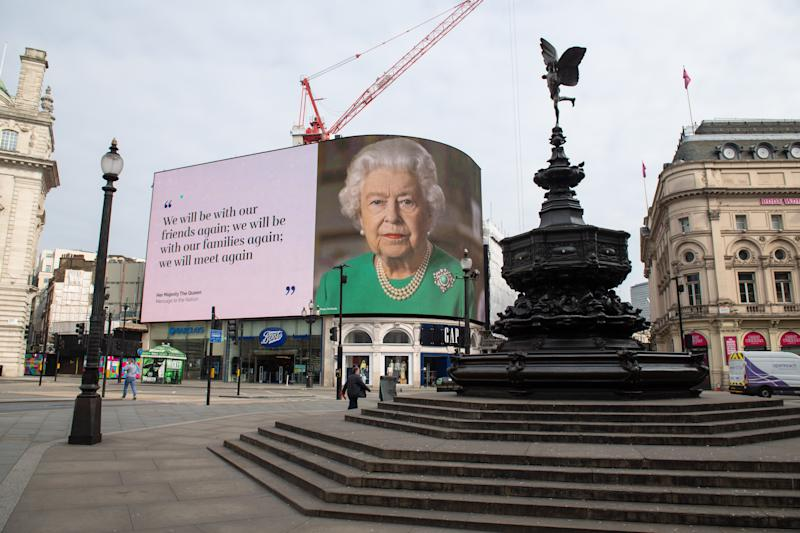 An image of Queen Elizabeth II and quotes from her broadcast on Sunday to the UK and the Commonwealth in relation to the coronavirus epidemic are displayed on lights in London's Piccadilly Circus. (Photo by Dominic Lipinski/PA Images via Getty Images)